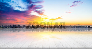 Business concept - Empty marble floor top with panoramic modern cityscape building bird eye aerial view under sunrise and morning blue bright sky of Tokyo