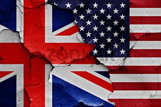 flags of UK and USA painted on cracked wall