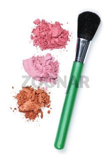 Crushed cosmetics with makeup brush
