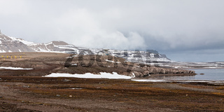 Mountain landscape and satellite dish in Ny Alesund, Svalbard islands