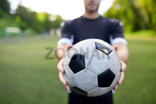 soccer player with ball on football field