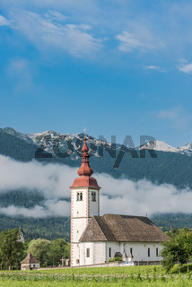 Cerkev in Bitnje, Slovenia at misty morning