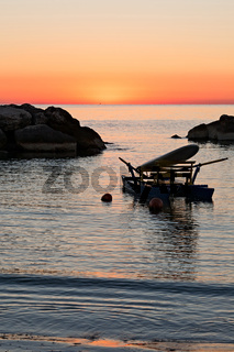 Pedalo moored in the sea just before the sunrise