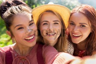 happy women or friends taking selfie at summer
