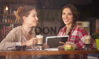 Best friends ladies in cafe