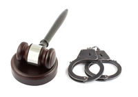 Wooden brown gavel and handcuffs