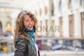 smiling woman in mall looking at camera
