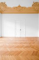 real estate interior , empty room with stucco ceiling and herringbone parquet floor -