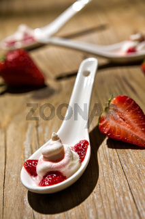 Close up of a mascarpone cheese and strawberries