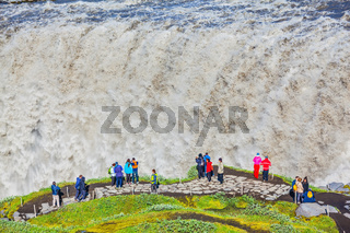 Tourists observes falling 'wall' of water