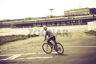 teenage boy riding his bike, vintage version