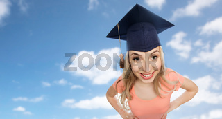 smiling young student woman in mortarboard