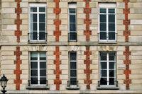 Windows with balconies.