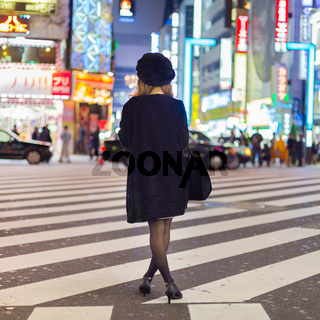 Solitary woman in Shinjuku, Tokyo, Japan.