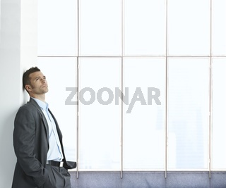 Portrait of businessman thinking
