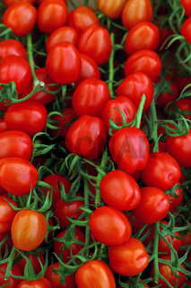 Close up fresh red cherry tomatoes in retail