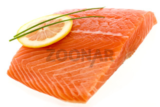 Salmon Fillet with lemon slice as closeup on white background
