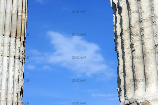 Blue clouded sky between two ancient Greek columns in Athens