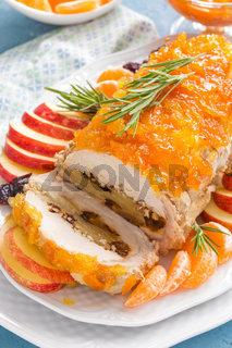 Meat loaf stuffed with apples and plums, decorated tangerine confiture. Christmas menu