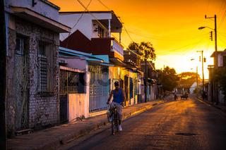 Man on bicycle in Cuban street