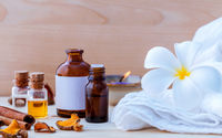 Natural Spa ingredients and bottle of herbal extract oil for alternative medicine and aromatherapy. Thai Spa theme with ayurvedic therapist on shabby wooden background.