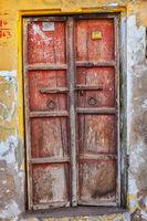 Ancient red wooden door