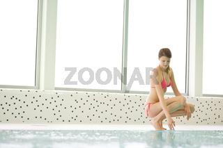 Swimming pool - beautiful woman in bikini
