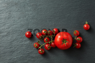 Tomatoes bunch on a black background