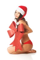 Santa woman sitting and covering her body by ribbon, looking like a gift