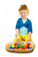 Happy little girl with easter eggs in a basket