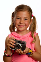 Young girl holding old camera