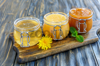 Different varieties of honey in a glass jars.
