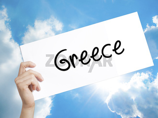 Greece  Sign on white paper. Man Hand Holding Paper with text. Isolated on sky background