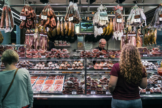 meat and sausage shop in la boqueria market barcelona spain