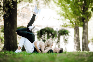 couple laying on the grass