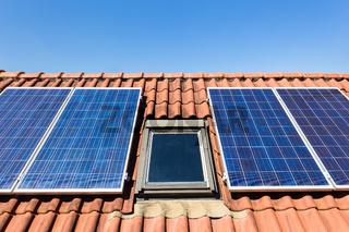 Blue solar collectors and attic window