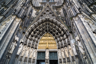 Entrance to Cologne Cathedral. Figures of saints on the facade.