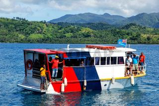 Colorful passenger boat leaving Korean Wharf on Taveuni Island, Fiji