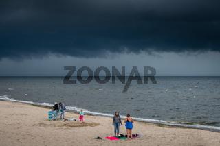 Sunbathers on a beach in Sarbinowo