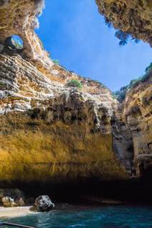 Limestone cave, open sky view on the Algarve, Portugal