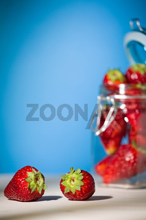 Strawberries on a table with blue background