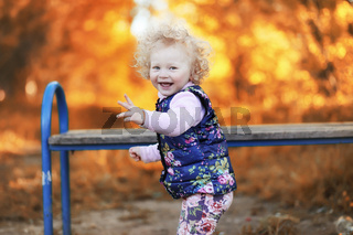 Girl walking in the autumn park. Autumn in the city, girl with d