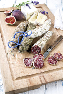 Salami with Camembert and Fig on Cutting Board