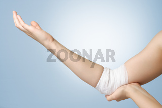 Injured elbow with bandage