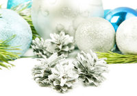 Three silver cones withfir tree branch, beautiful silver ball close up