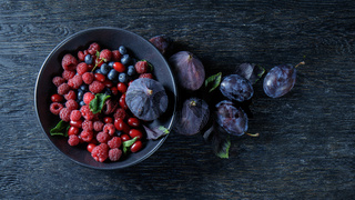 figs and berries on a bowl
