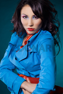 Sexy fashionable woman in blue jacket