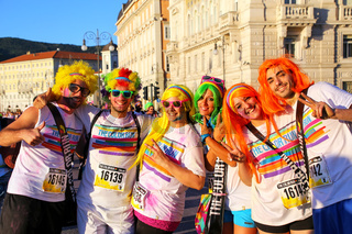 People posing for photos during The Color Run in Trieste, Italy.