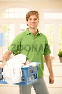 Guy taking clothes to wash