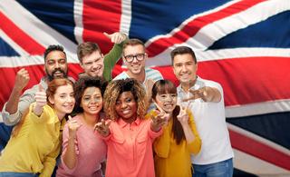 international people gesturing over british flag